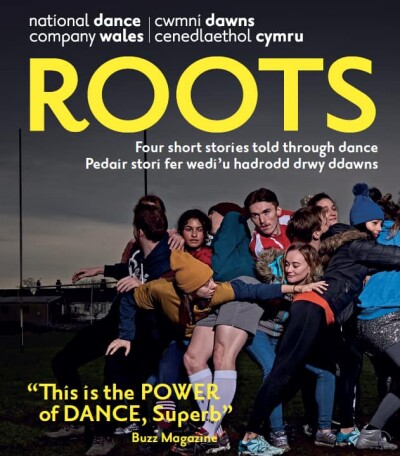 A poster of NDCWales Roots tour with the title ROOTs in yellow at the top and an image of a group of dancers squashed together in a scrum of bodies
